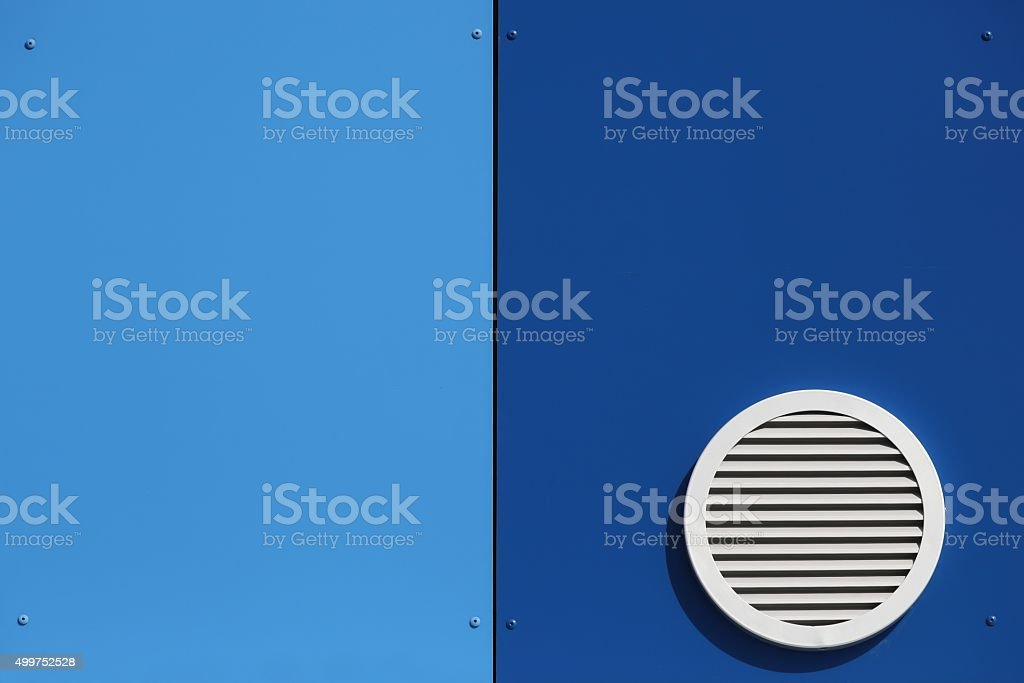 Ventilation system and circle vent window on a wall stock photo