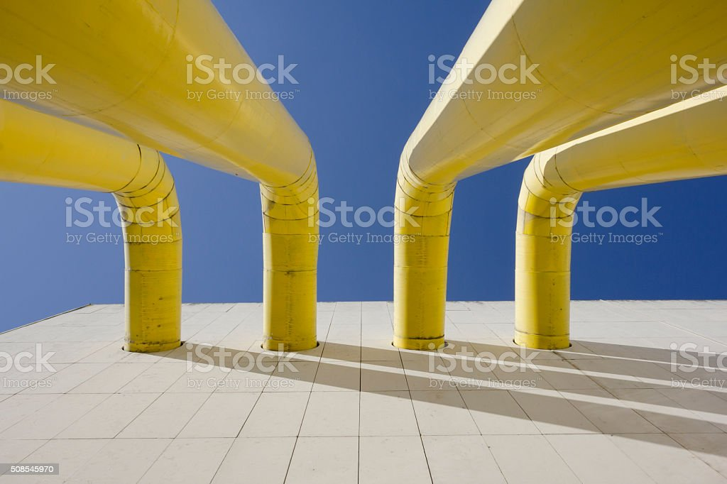 Ventilation tubes out of building wall stock photo
