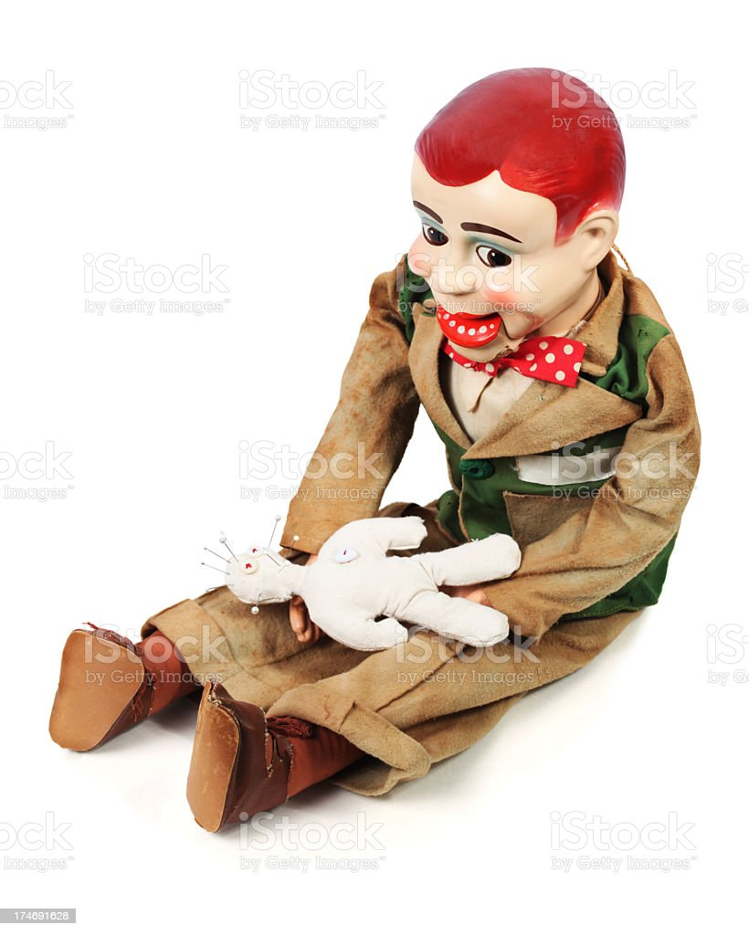 Ventriloquist's Dummy and voodoo doll stock photo