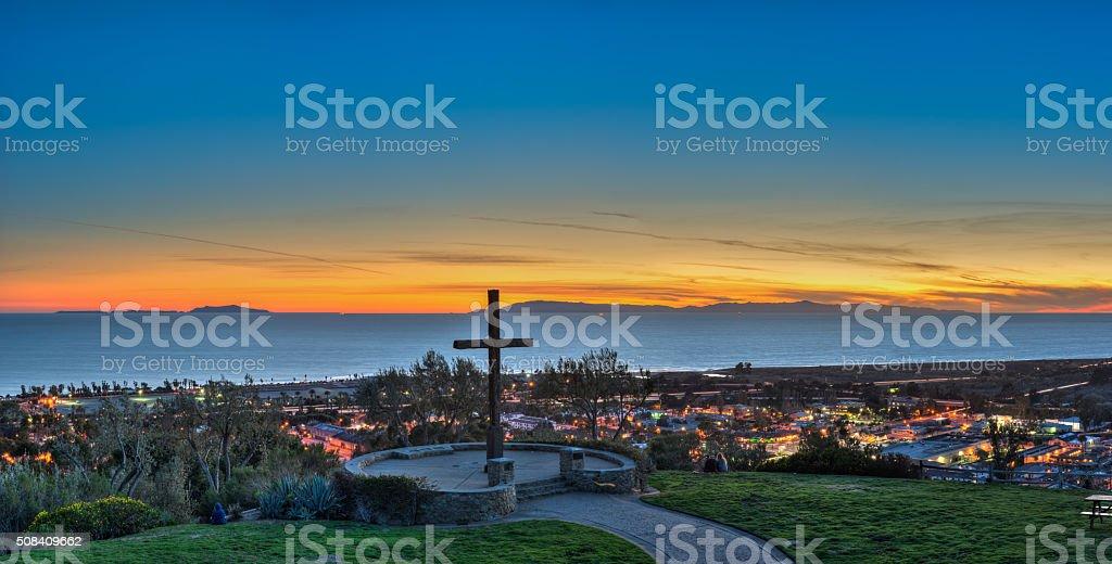 Ventura city lights under landmark cross stock photo