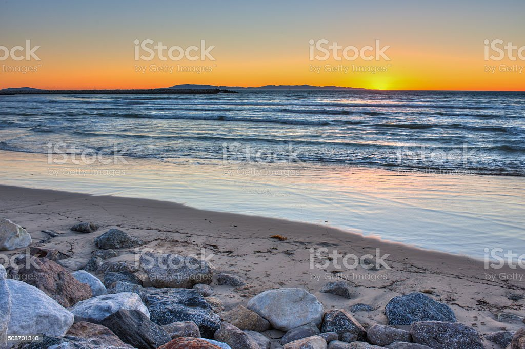 Ventura sunset behind the waves stock photo