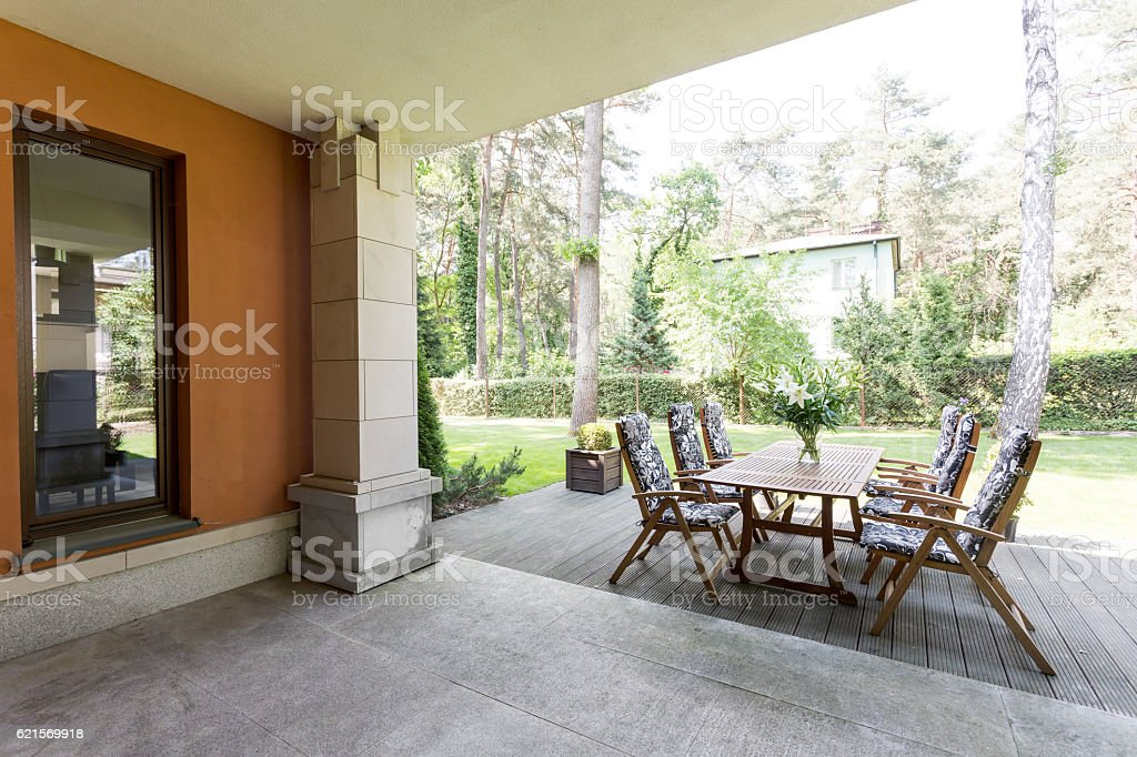Veranda with wooden table and chairs stock photo