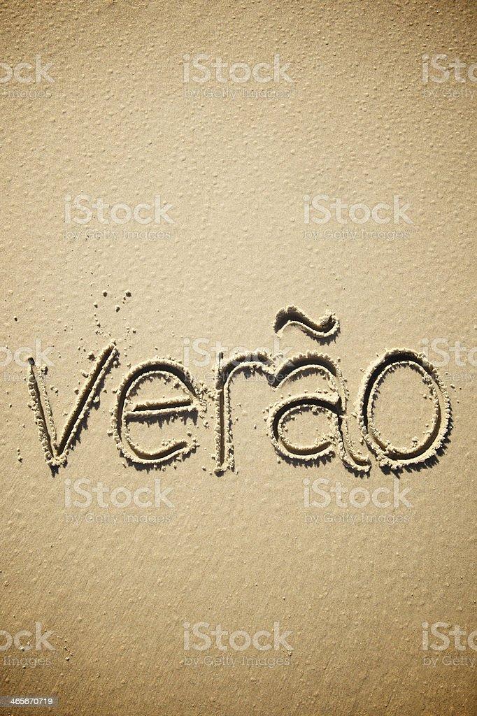 Verao is Brazilian Portuguese for Summer Message in Sand stock photo