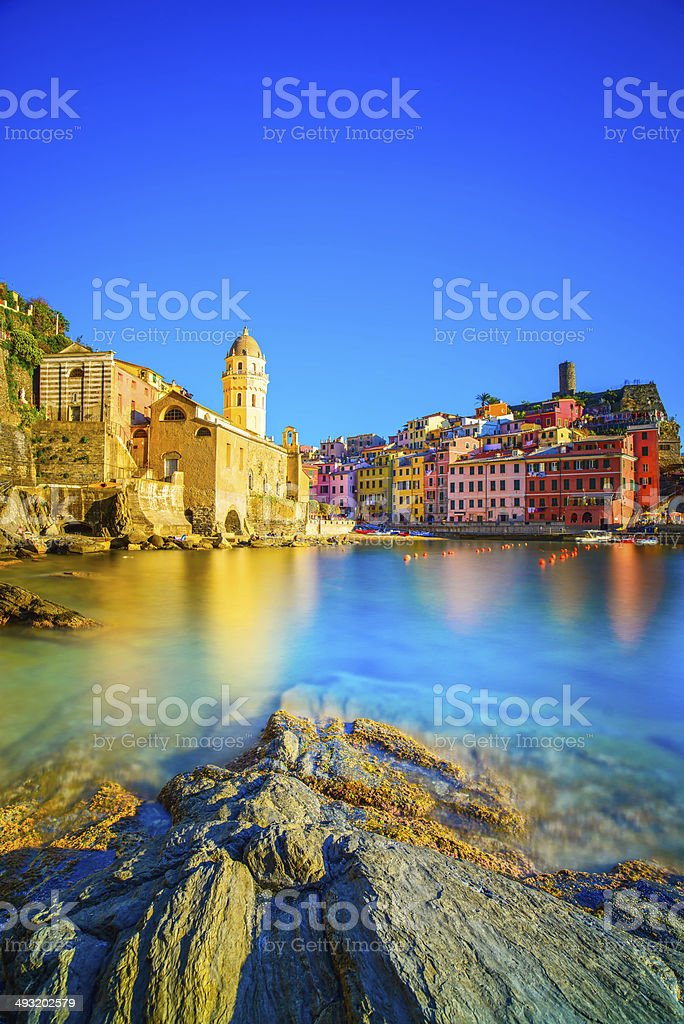 Vernazza village, church, rocks and sea harbor on sunset. Cinque stock photo