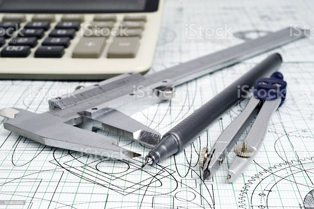 vernier callipers , calculator, compasses, and drawings royalty-free stock photo