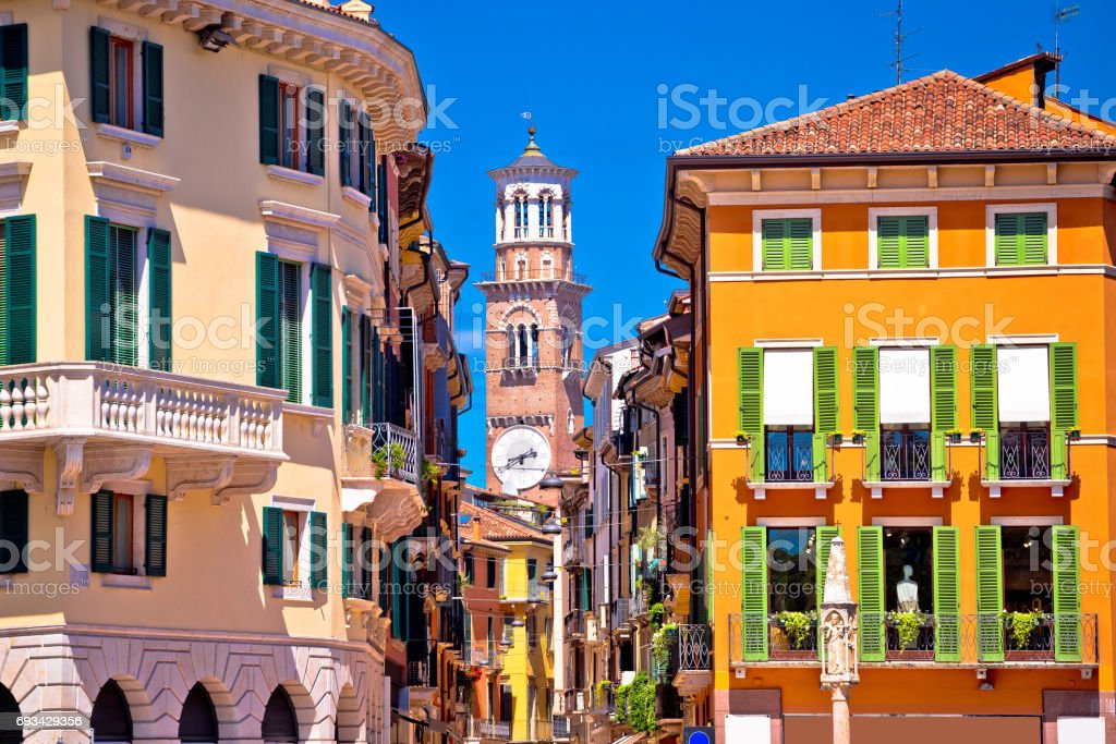 Verona colorful street and Lamberti tower view, tourist destination in Veneto region of Italy stock photo