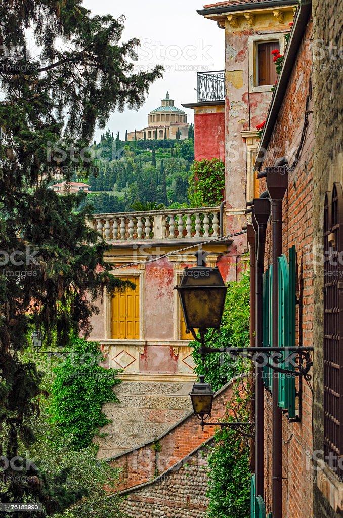 Verona Italy alley and Santuario Madonna di Lourdes stock photo