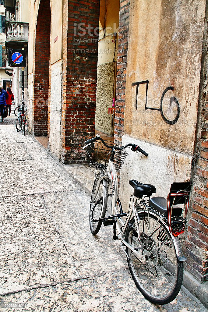 Verona, Italy - March 20, 2010 - Old bicycle on street stock photo