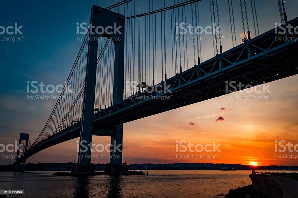 Verrazano bridge connecting Brooklyn to Staten Island at dusk stock photo