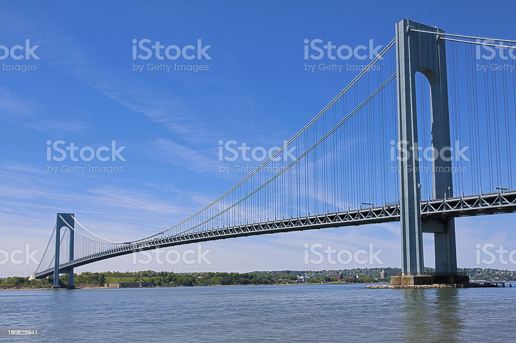 Verrazano-Narrows Bridge, New York. Clear blue sky with some clouds. stock photo