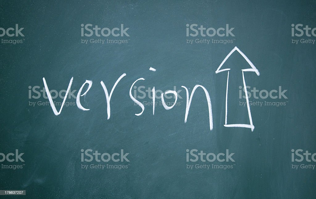 version Upgrade symbol drawn with chalk on blackboard royalty-free stock photo