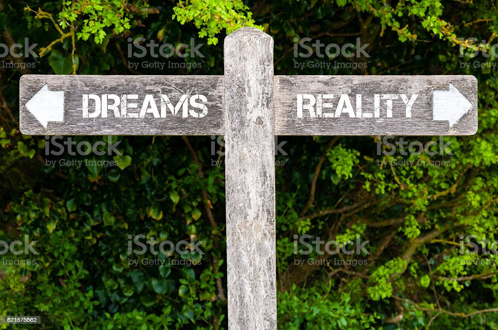 DREAMS versus REALITY directional signs stock photo
