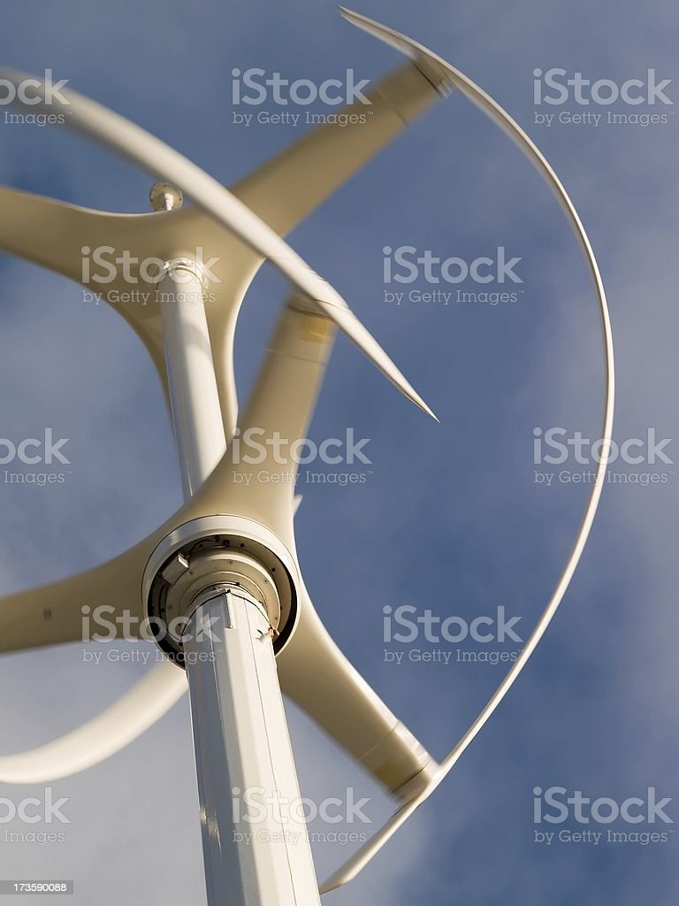 Vertical axis wind turbine rotating with motion blur stock photo