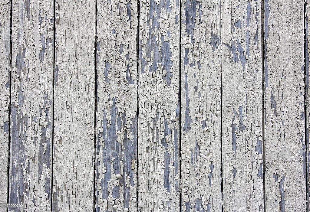 vertical beige wooden planks with peeling paint, texture stock photo