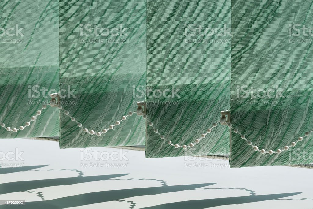 Vertical blinds on the window stock photo