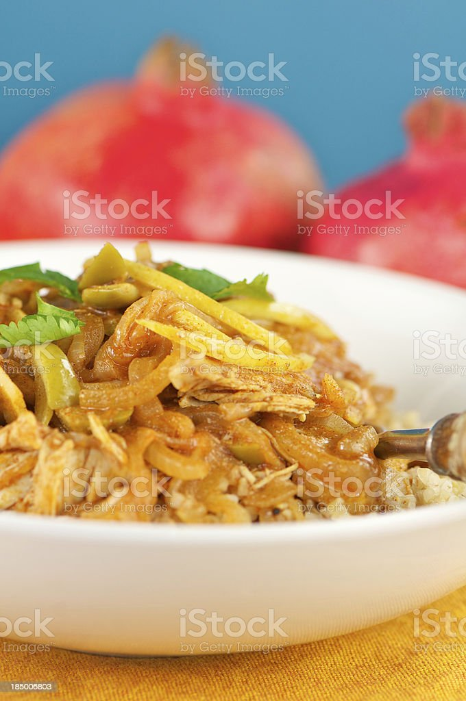 Vertical Bowl of Moroccan Chicken with Preserved Lemons royalty-free stock photo