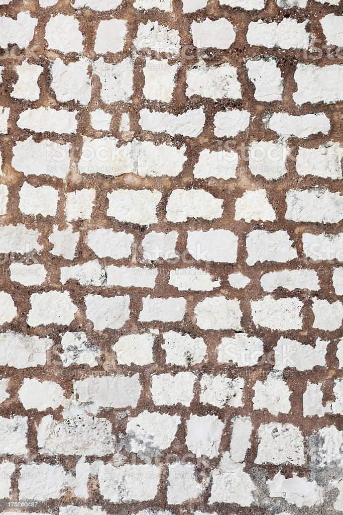 vertical brown and white  artificial rugged rock wall background Croatia royalty-free stock photo