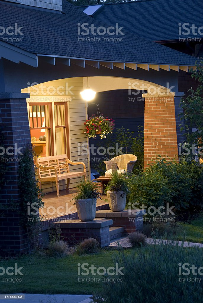 Vertical, bungalow night front porch stock photo