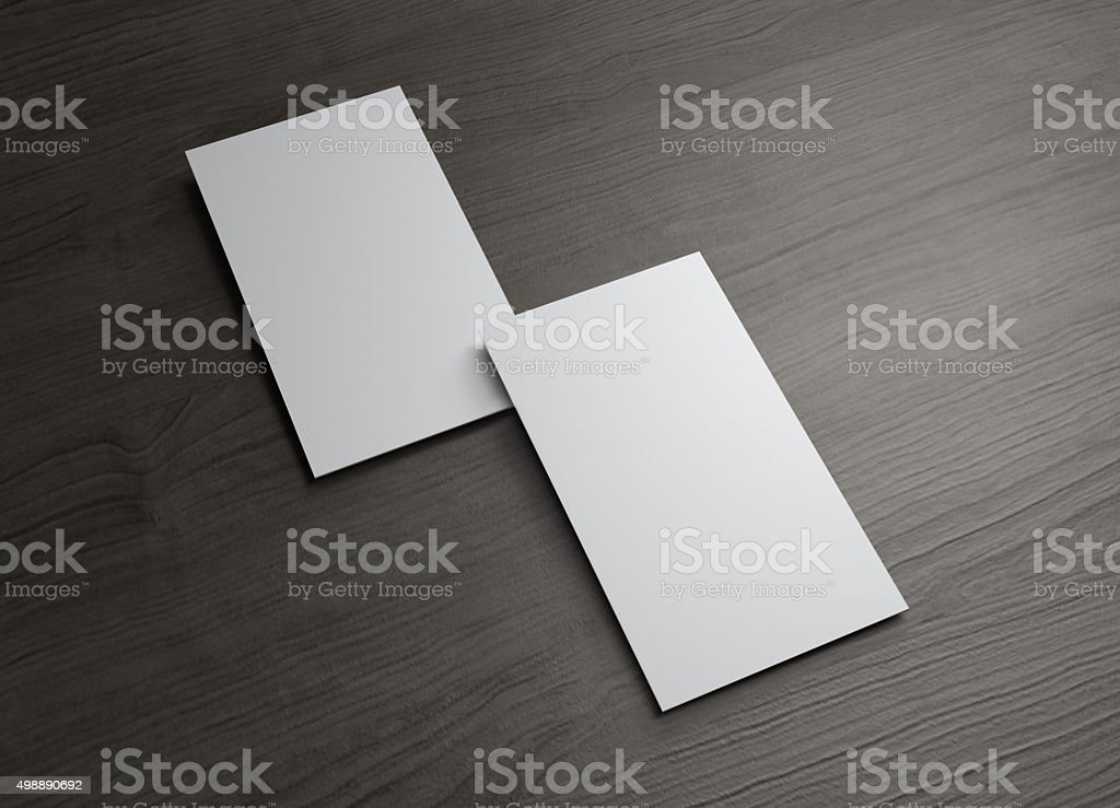 Vertical Business cards overlap on wood table stock photo