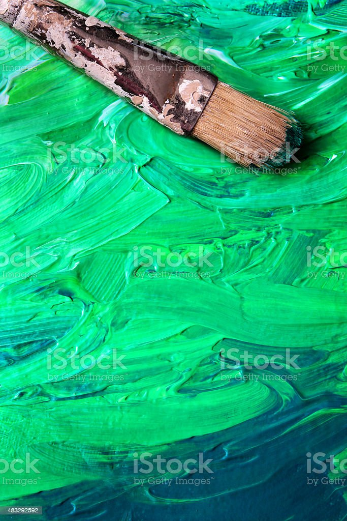 Vertical Canvas with Paint and brush stock photo
