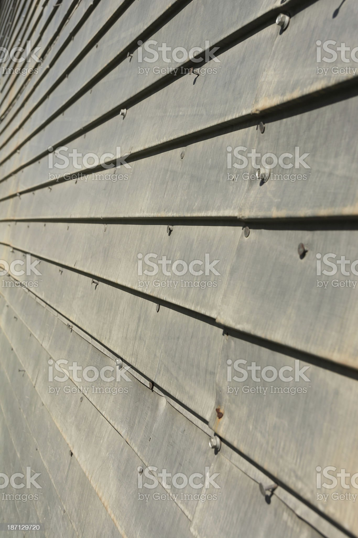 Vertical closeup of metal siding on old building. royalty-free stock photo