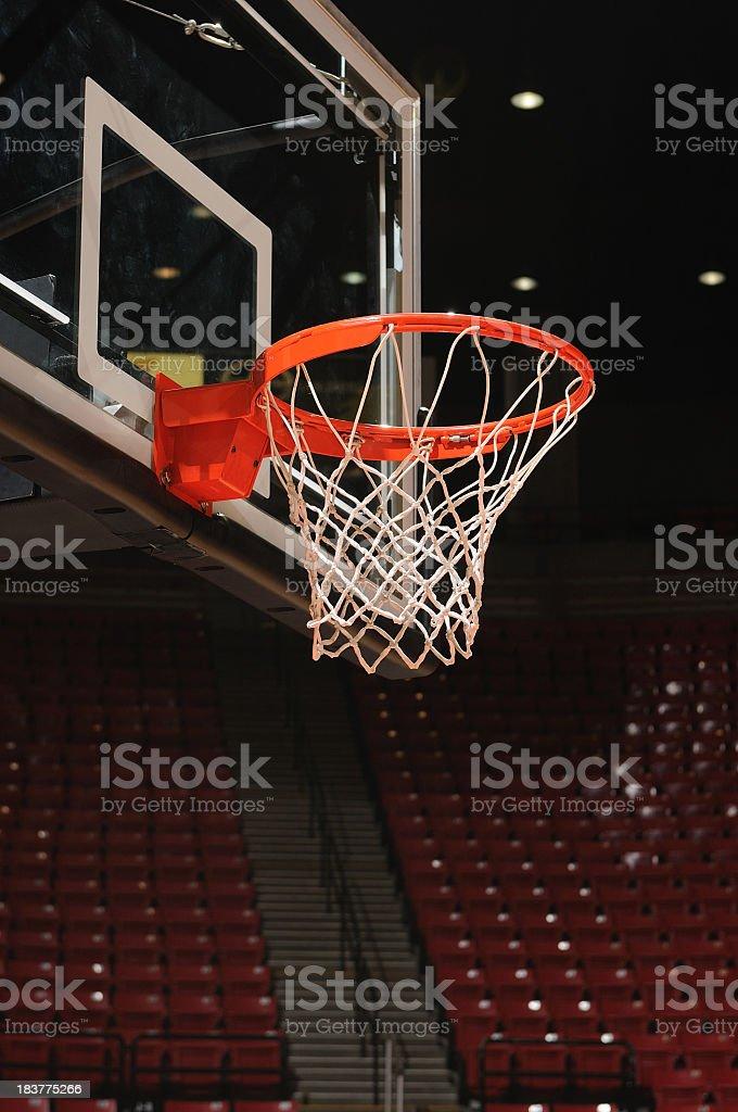 Vertical dark photo of a basketball hoop royalty-free stock photo
