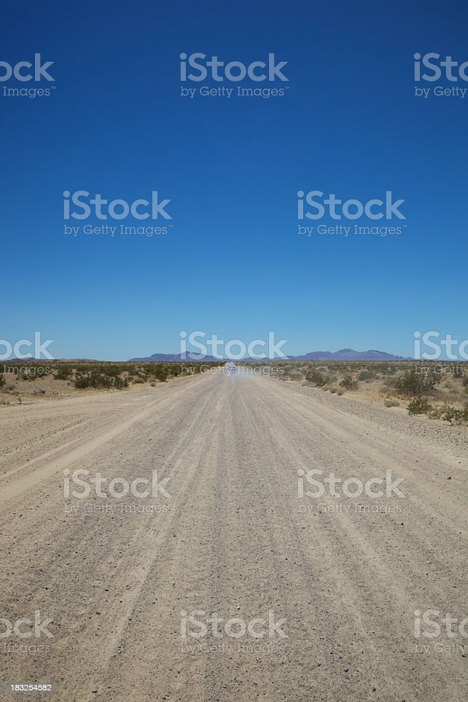 Vertical Desert Dusty Western Road royalty-free stock photo