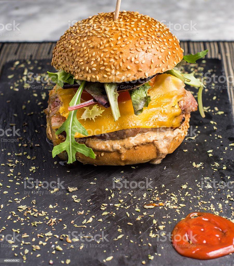 vertical front burger ketchup chessburger cheeseburger salad gourmet bokeh chesse stock photo