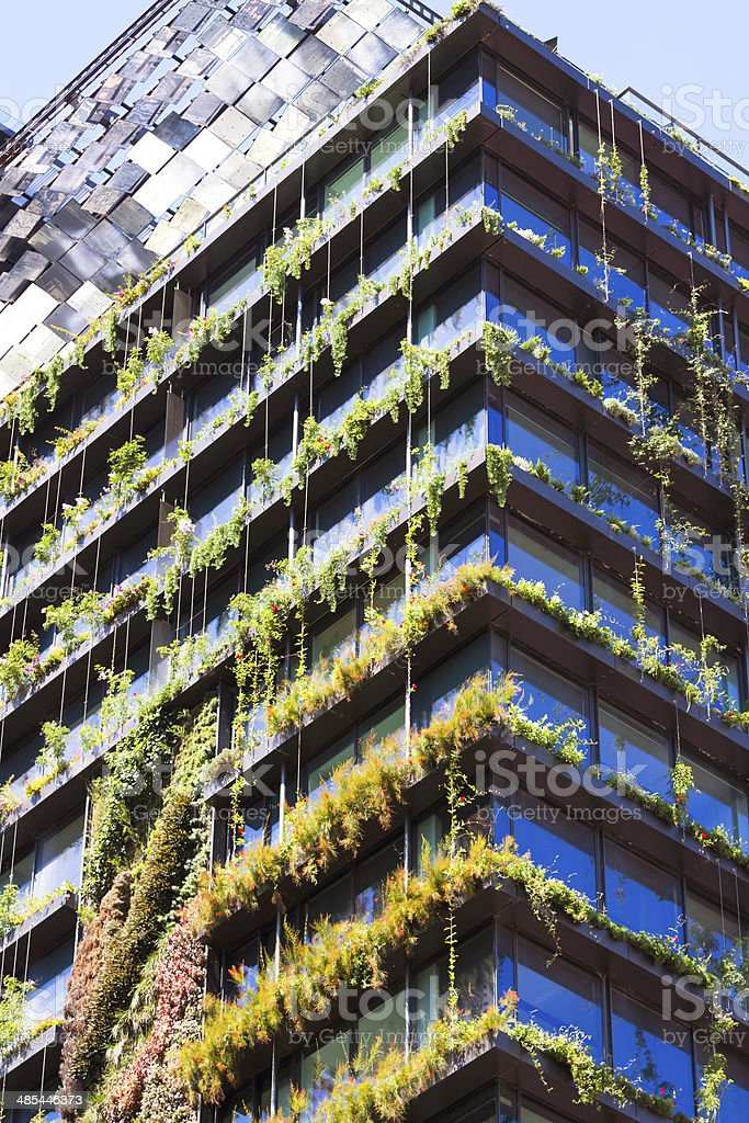 Vertical garden - green wall and heliostat on residential building stock photo