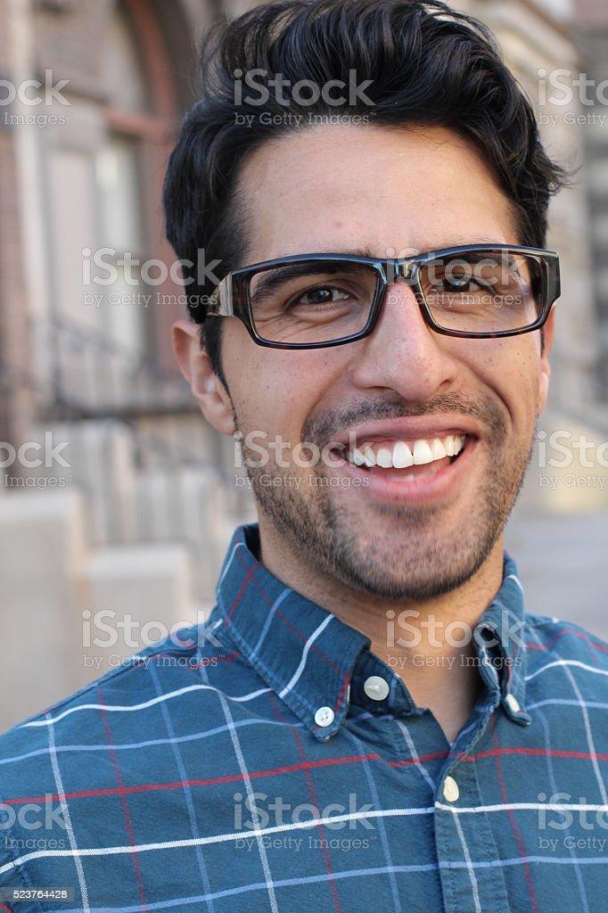 Vertical handsome smiling confident man portrait stock photo