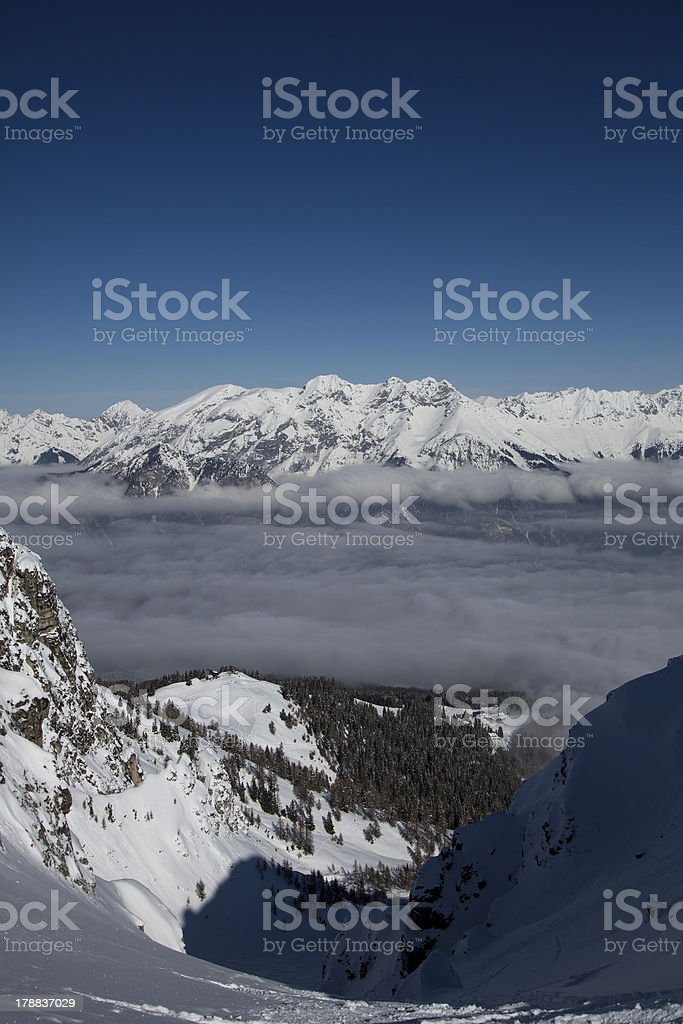 Vertical image of clear blue sky above mountains and clouds royalty-free stock photo