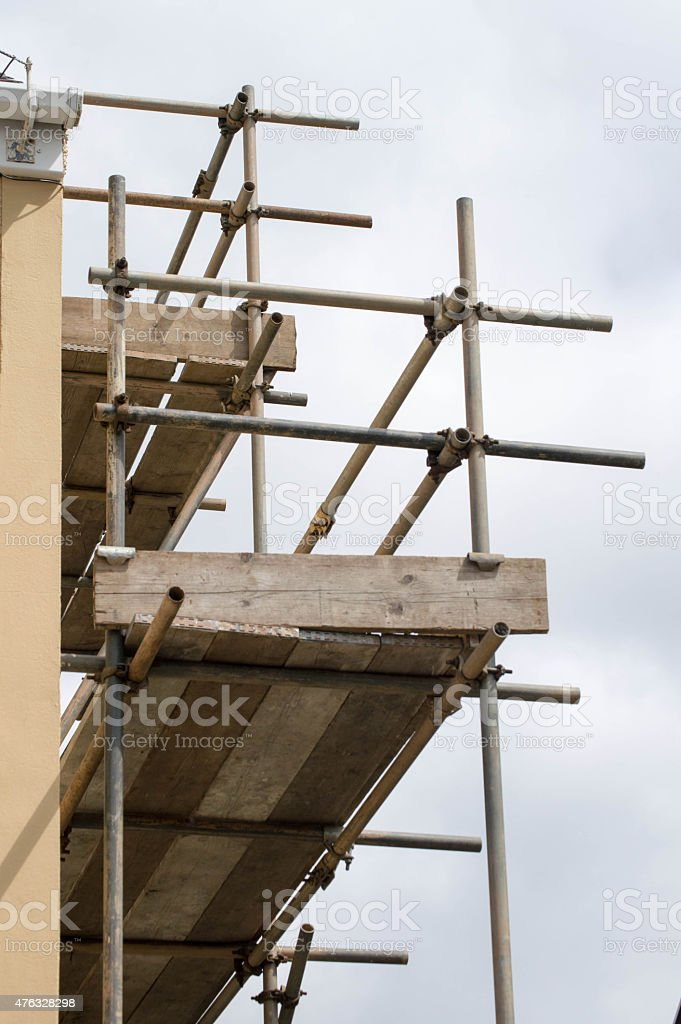 Vertical image of scaffolding against the side of a buildng stock photo