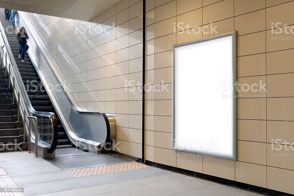Vertical light box poster mockup in metro station. stock photo
