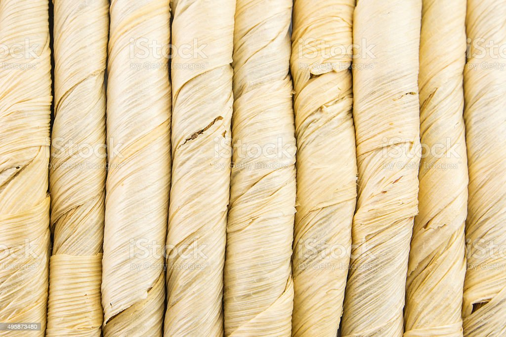vertical lines of straw like material stock photo