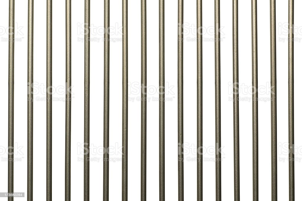 Vertical metal jail bars on white background stock photo