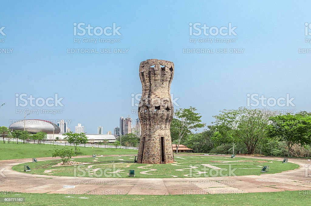 Vertical monument to the indigenous people in park stock photo