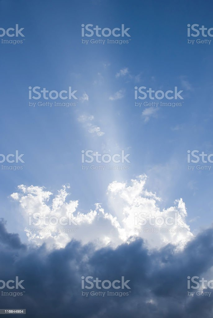 Vertical Nature Background with Blue Sky Puffy Clouds and Sunbeam royalty-free stock photo