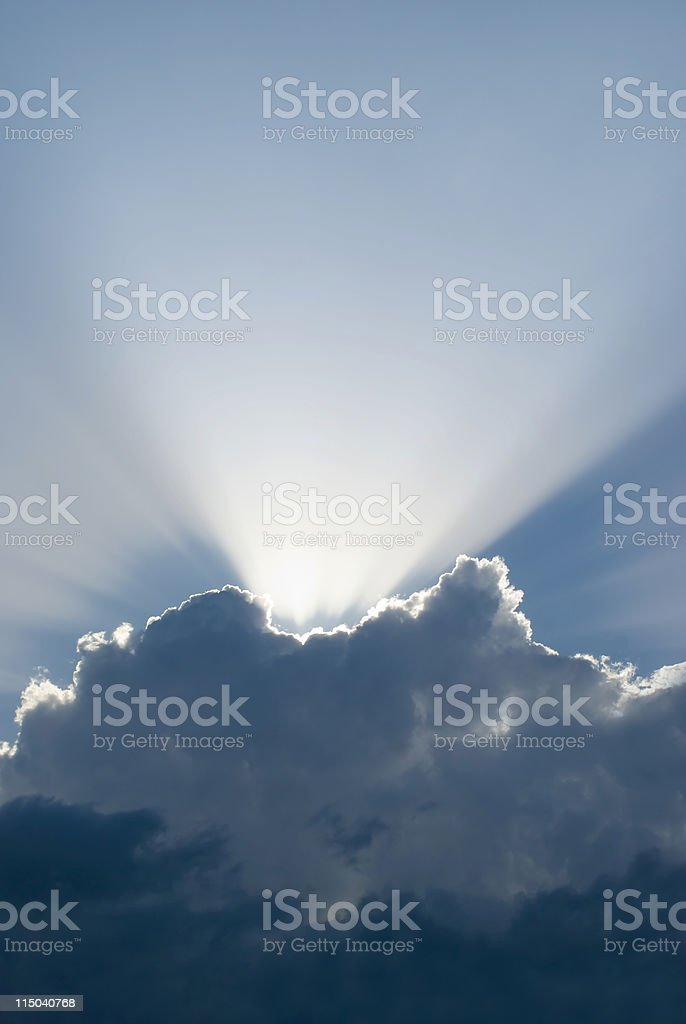 Vertical Nature Background with Grey Sky Puffy Clouds and Sunbeam royalty-free stock photo
