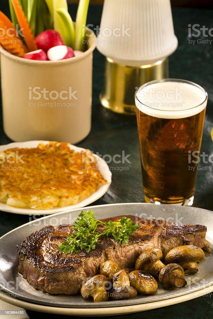 Vertical of Rib Eye, Hash Browns, Beer - adobe RGB royalty-free stock photo