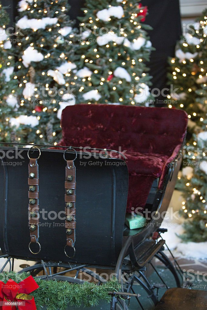 Vertical Old Fashioned Sleigh and Christmas Trees stock photo