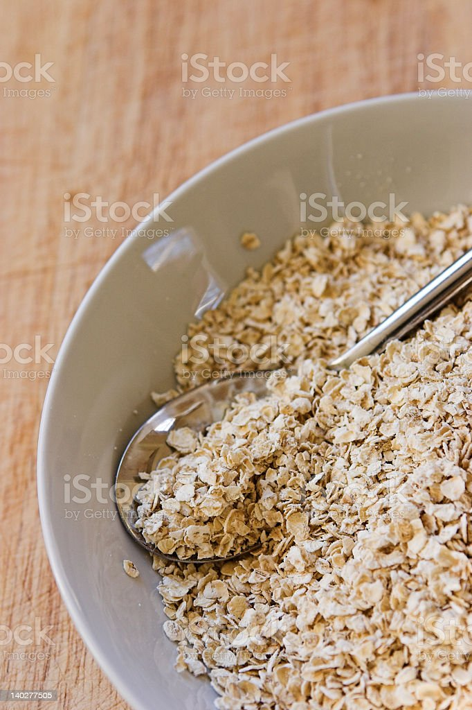 A vertical photo of a bowl of raw cereals royalty-free stock photo
