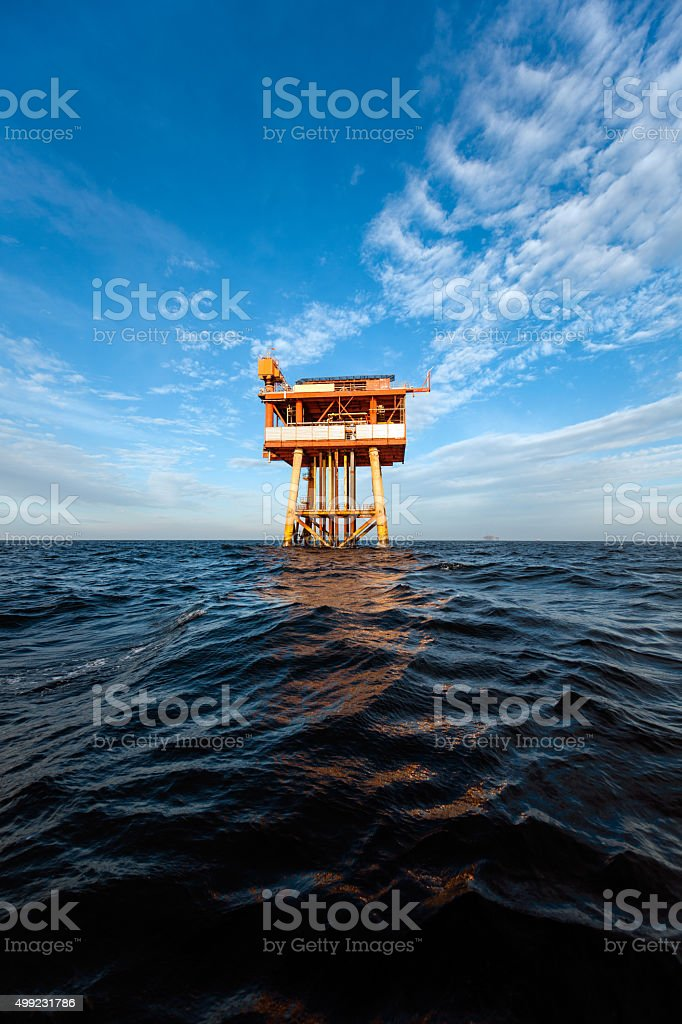 Vertical photo of an oil platform at sunny day stock photo
