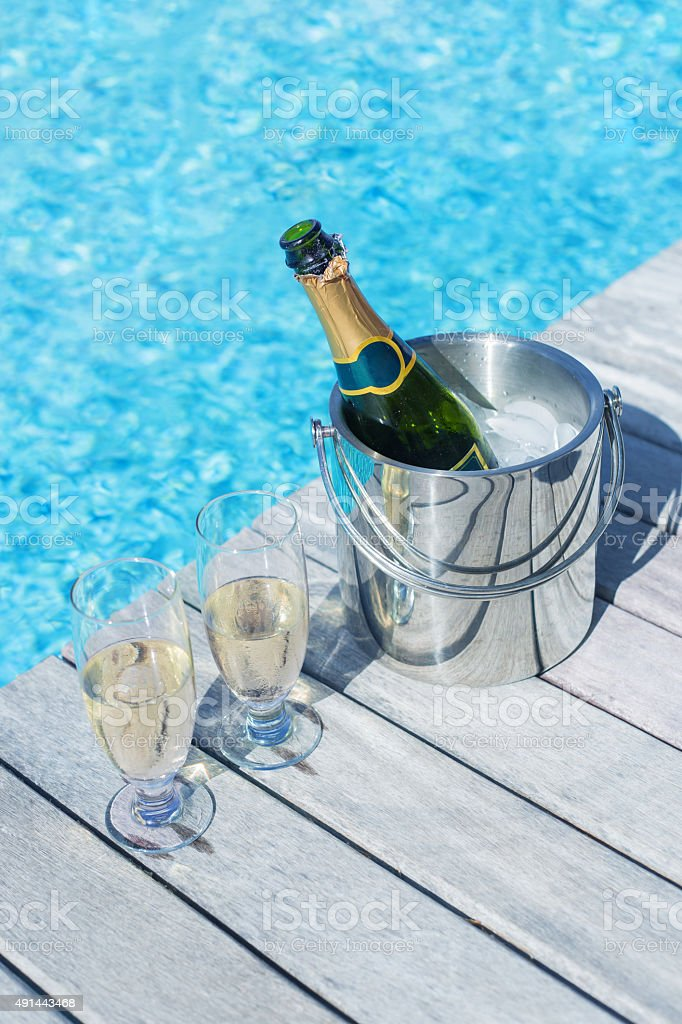 Vertical photo of champagne bottle in bucket and two glasses stock photo