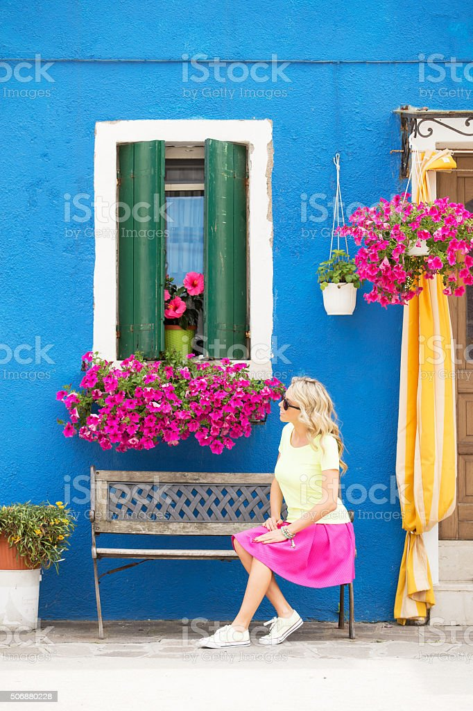 Vertical photo of romantic lady sitting on bench stock photo