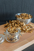 Vertical photo of sliced and dried various mushrooms