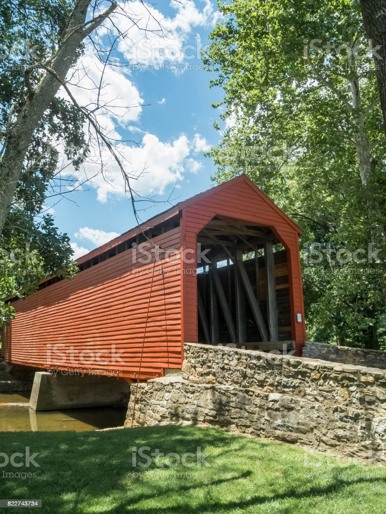 Vertical Photo Of The Roddy Road Covered Bridge In The Summer stock photo
