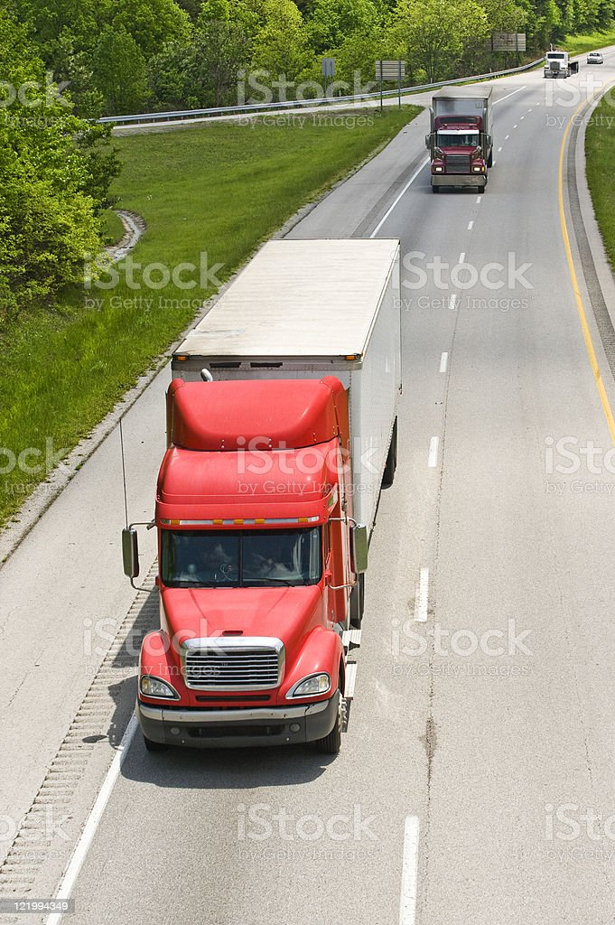 Vertical Photo of Trucks On Interstate Highway royalty-free stock photo