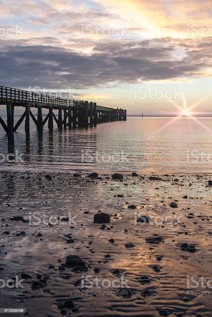 Vertical pier with flare stock photo