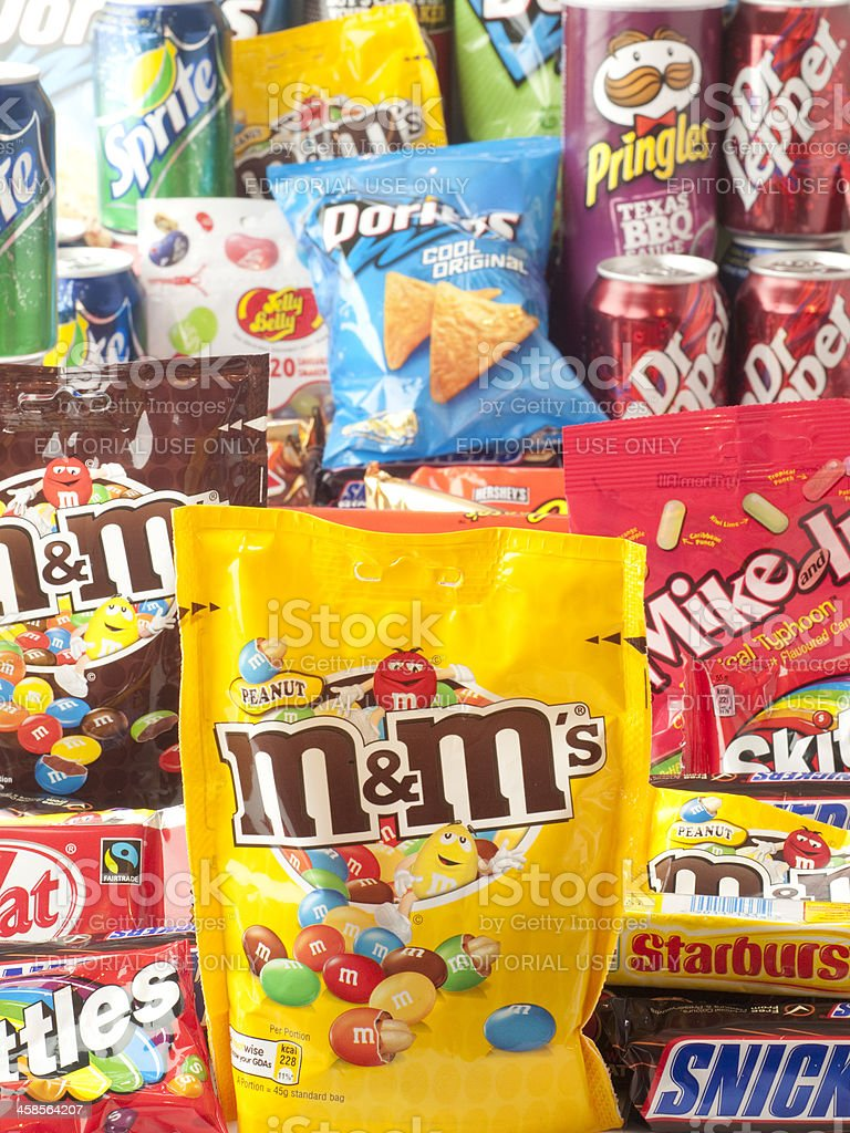 Vertical pile of junk food focus on MandMs royalty-free stock photo