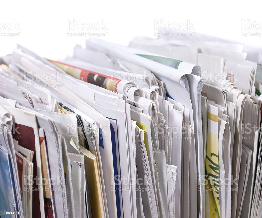Vertical pile of newspapers and flyers royalty-free stock photo